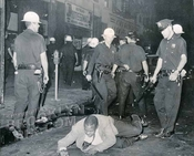Police using force at Gates Avenue looking west to Bedford Avenue, 1957