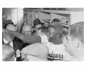 Jackie Robinson in the Dodgers locker room with the Press after the game