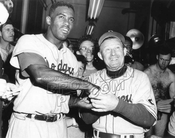 Jackie Robinson with Mgr. Chuck Dressen,. Who's exposing himself at far right?