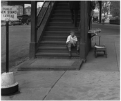 kid waiting at the Broadway Train Station