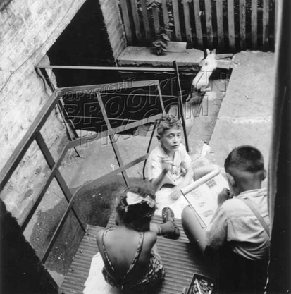 Kids playing in courtyard of a Sutter Avenue tenement, 1948