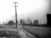 Kings Highway prior to widening, looking west to Utica Avenue showing Garret Kouwenhoven Homestead, 1923