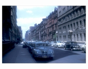 Classic Cars parked on a quiet street in mdtown Manhattan NY circa 1940