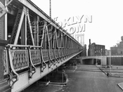 Manhattan Bridge from Brooklyn, new Brooklyn-Queens express in middle ground, 1959