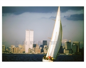 Manhattan skyline with Twin Towers behind a sailboat