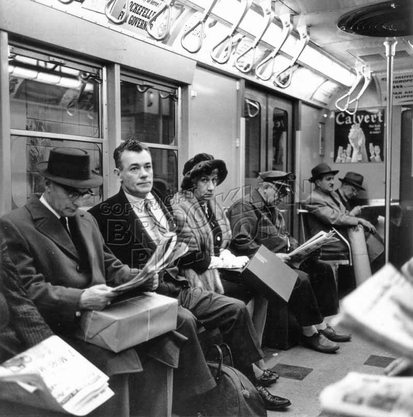 Morning commuters reading the news, c.1955 Manhattan