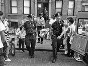 """New York's Finest"" from 68th Precinct assisting injured person, c.1960"