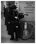 Old timer street Violinist outside of 40 Wall Street  Civic Center Downtown Manhattan