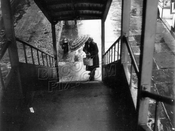 Out of the rain and up the stairs, c.1955