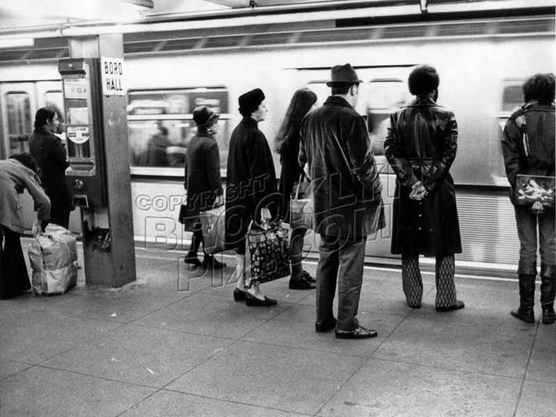 "Passengers wait for the doors to open on a ""Redbird"" train at Borough Hall station, c.1970"
