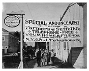 Patchogue LI - sign advertising free telephone calls for farmers - 1915