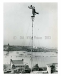 Performers atop a 140 foot pole in the amusement area at the World Fair 1939 Flushing  - Queens NYC