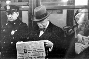 Reading the Journal American on the IRT, c.1960