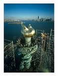 Statue of Liberty - new Torch & Flame with Manhattan Skyline in background - workers begin to dismantle the scaffolding