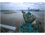 Statue of Liberty - view of flame & torch platform looking east with lower Manhattan in the background