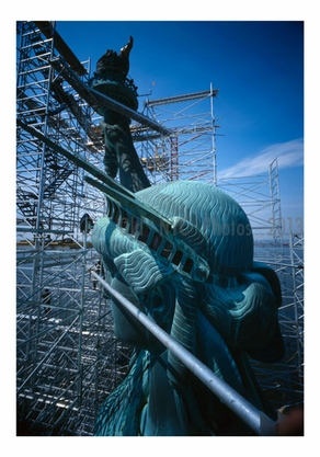 Statue of Liberty - view of left side of head looking at ear with torch arm in background