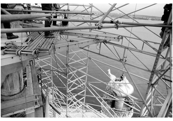 Statue of Liberty - view of new flame & torch assembly being hoisted into place November 25, 1985