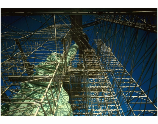 Statue of Liberty - view wlooking straight up at torch arm showing scaffolding & draped robe