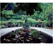 "Statue of Mary & Dickon from Frances Hodgson Burnett's ""The Secret Garden"" at the reflecting pool of the conservatory Garden in Central Park"