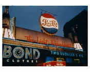Times Square at night with a Pepsi Neon sign in focus 1958 New York, NY