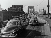 Trolley descending Brooklyn Bridge into Brooklyn on former el tracks near end of operation, 1950