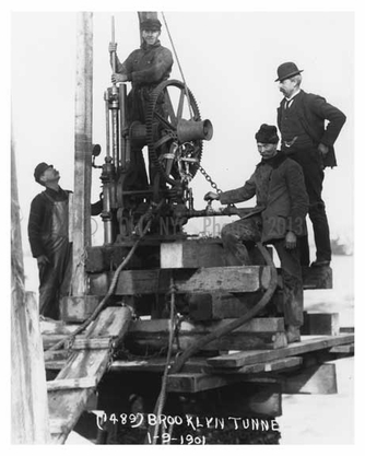 up close shot of Workers in 1901 Construction of the Brooklyn Tunnel on the East River