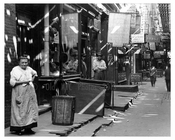 An up close view of people and shops on Greenwich Street - Greenwich Village - Manhattan  1914