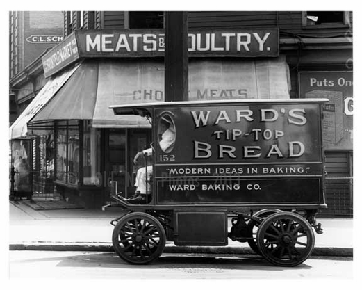 Upclose shot of a bakery truck & Butcher shop on St. Ann's & Westchester Ave - Bronx, NY  1917