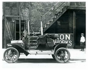 Upclose shot of a (now) classic Ford outside of Iron Works on 7th Avenue  - Midtown Manhattan - 1914