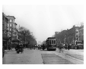 Upclose street view of Lenox Avenue & 125th Street Harlem, NY 1910