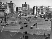 View across Grand Army Plaza showing Central Library and apartment houses along Eastern Parkway, early 1930s