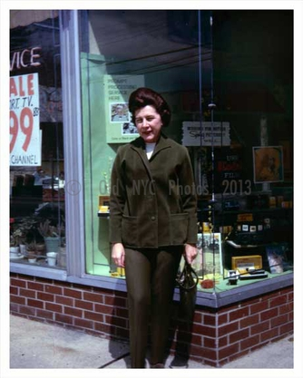 Woman posing outside a Kodak Photo Store in the 1966