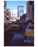 Yellow taxis roll through  1970s Times Square