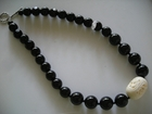 Carved White Bone Oval and Black Glass