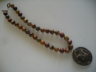 Gaea's Ceramic Chocolate Brown Owl on Red Creek Jasper 12mm