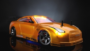 Exceed RC 2.4Ghz MadSpeed Drift King Brushless Edition 1/10 Electric Ready to Run Drift Car w/ LED Head Lights (SK-Yellow)