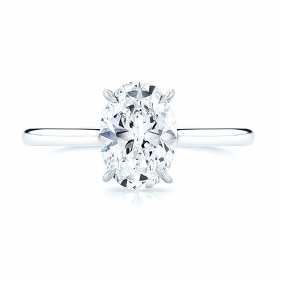 14kt Classic Solitaire Style Ring With 1.15 Carat SI-2 E Oval Diamond