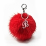 Monogram Key Chain With Faux-Fur Pom Pom