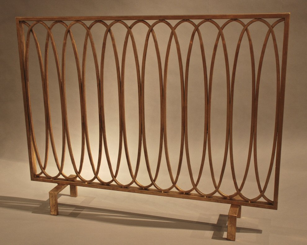 Provide natural appeal to your home decor with this antique gold oval loop iron fireplace screen. Bring richness and character to your home when you use this iron fireplace screen. Complementing and enhancing your decor is easy when you use this iron screen. It is an exceptional accent that will be an outstanding focal point that you will truly be proud of. Fireplace scree
