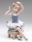 Ballerina Girl Sitting on a Chair Porcelain Sculpture