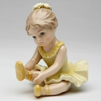 Ballerina Girl Stretching Her Leg Porcelain Sculpture