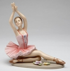 Ballerina in a Pink Dress Posing Porcelain Sculpture