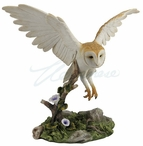 Barn Owl Bird Flying Over a Branch Sculpture
