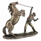 Bronze Cowboy Taming a Horse Sculpture