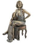 Bronze Pinup Girl Sitting with Left Hand Akimbo Sculpture