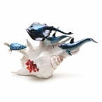 Dolphins Stingray and Turtle Swimming on Sea Shell Statue