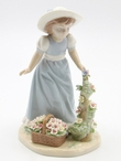 Girl Collecting Flowers Porcelain Sculpture by Nadal