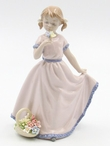 Little Girl Smiling and Holding Flowers Porcelain Sculpture by Nadal