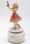 Little Girl with Nutcracker Porcelain Musical Music Box Sculpture