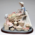 Mother and Daughter with Flowers Wagon Porcelain Sculpture by Nadal